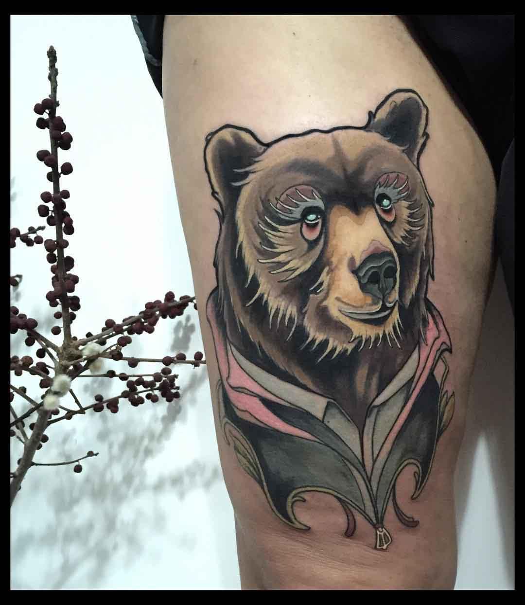 bear tattoo on thigh