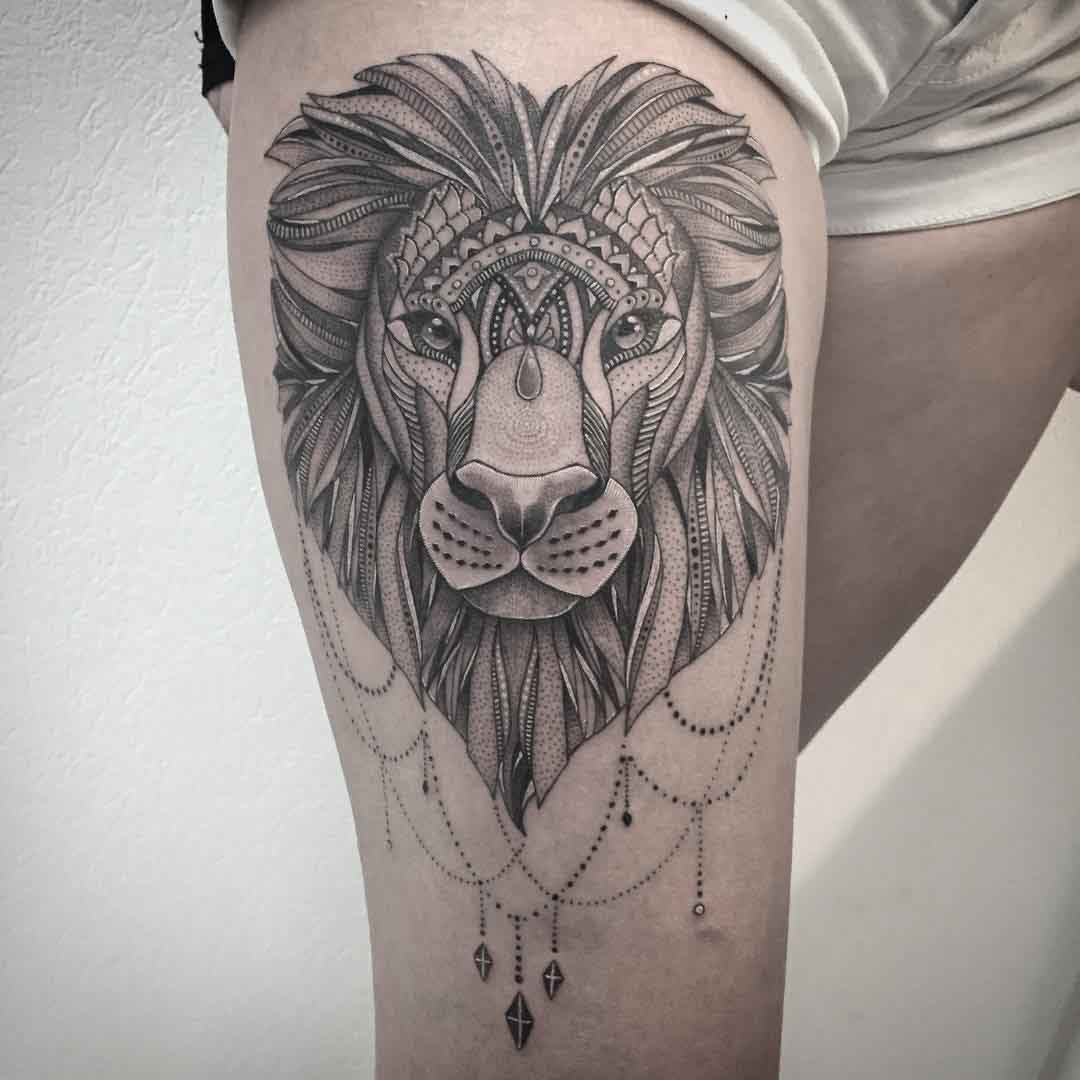 mehndi lion tattoo on thigh for girls