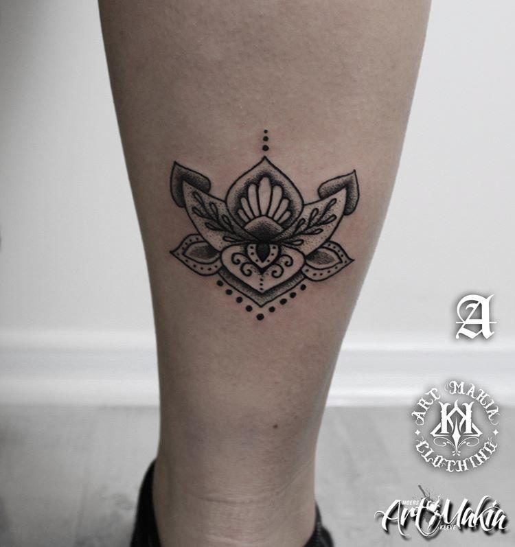 eastern themed lotus flower tattoo on leg
