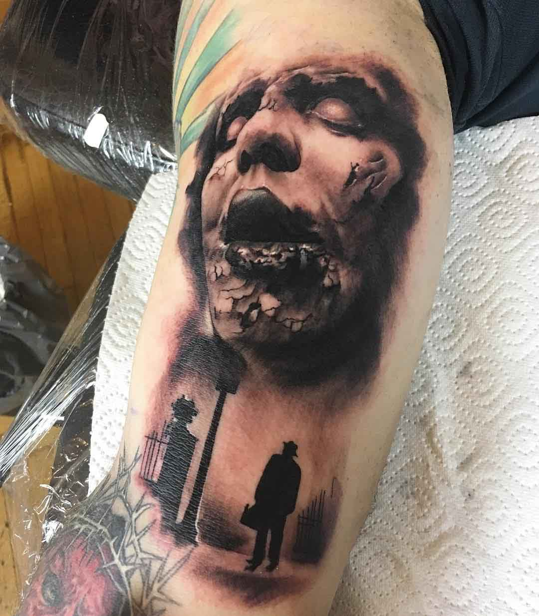 back bicep horror tattoo