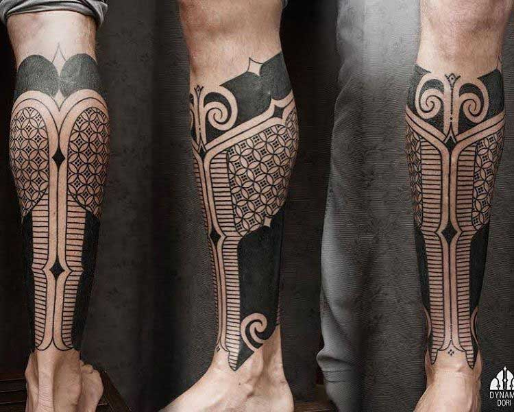 tribal tattoo on leg with geometric elements