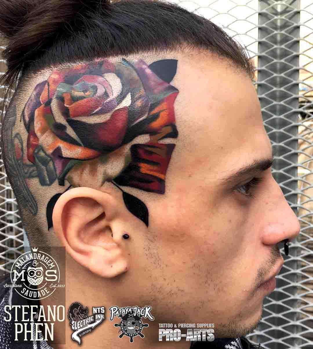 rose tattoo on the side of the head