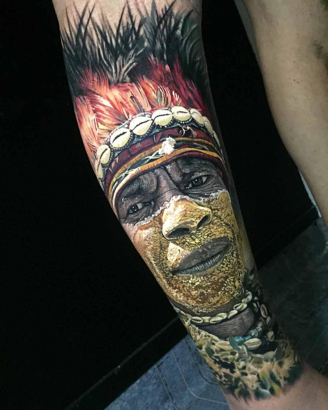 Indian man realistic portrait tattoo on arm