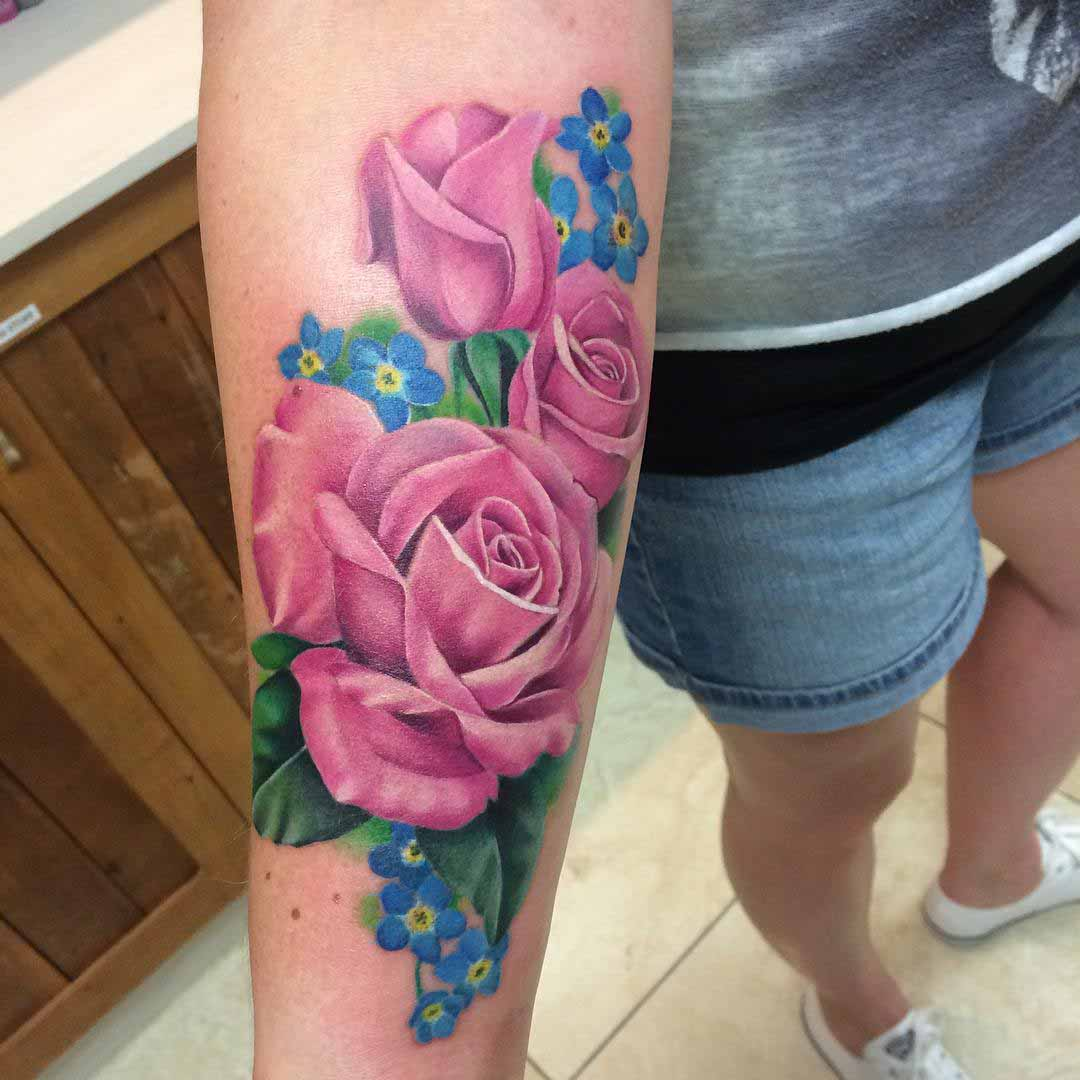 roses tattoo on forearm