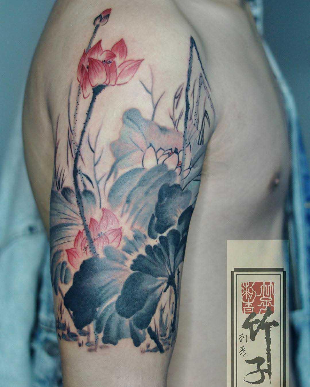 shoulder flowers tattoo pale colors