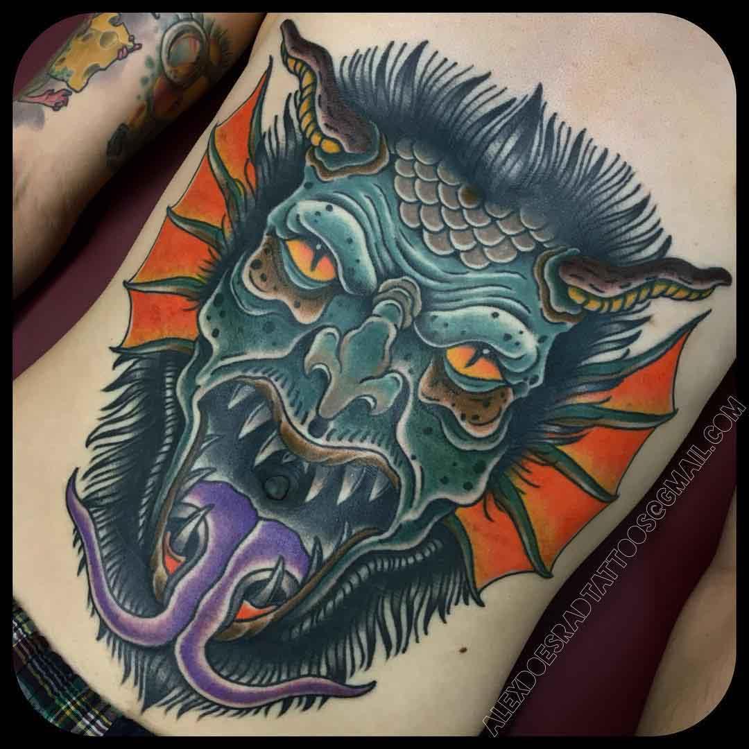stomach tattoo demon