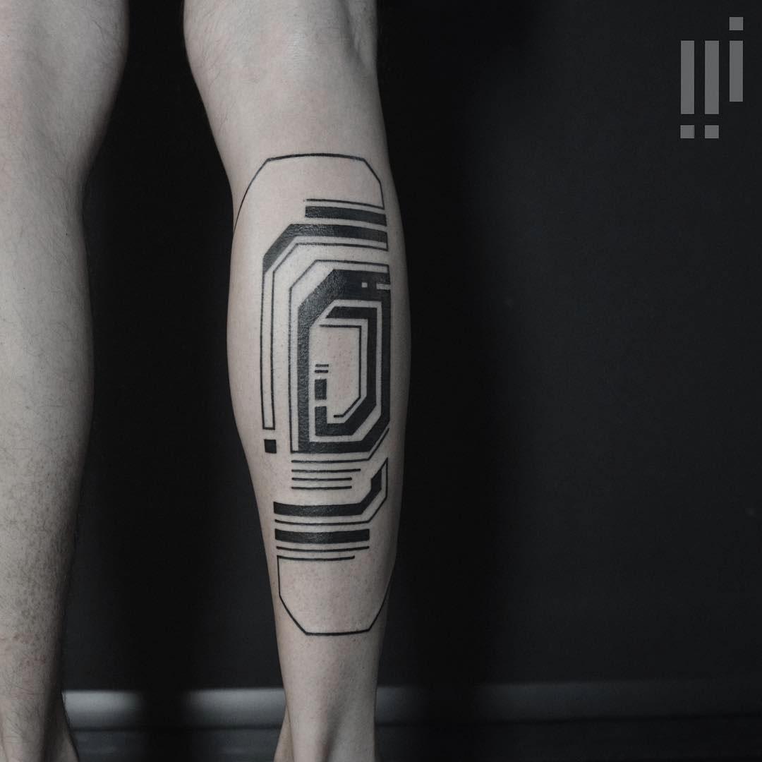 blackwork tattoo on calf