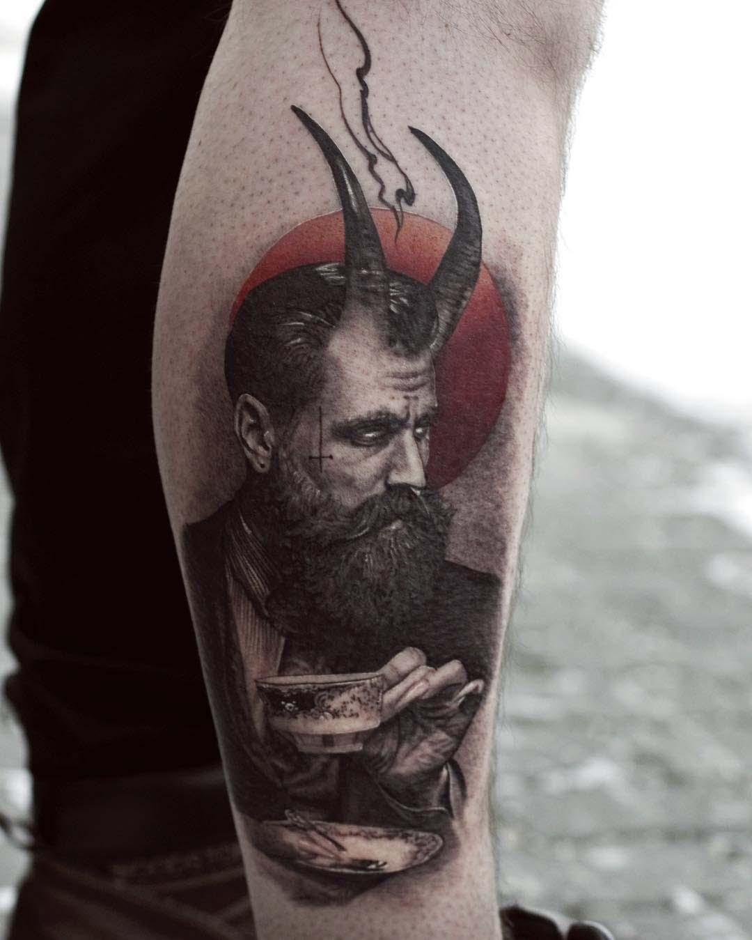 calf tattoo devil man