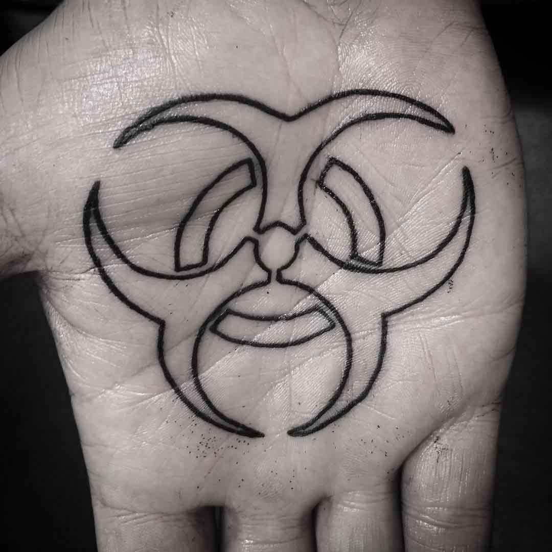 biohazard-tattoo-on-palm-by-erpenombra