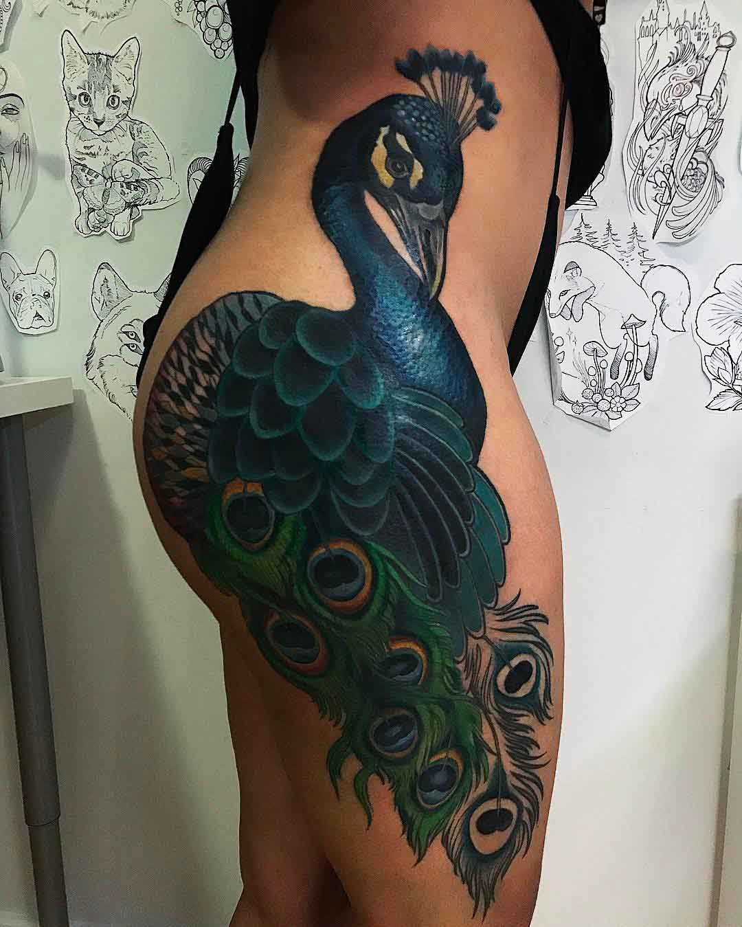 hip tattoo peacock