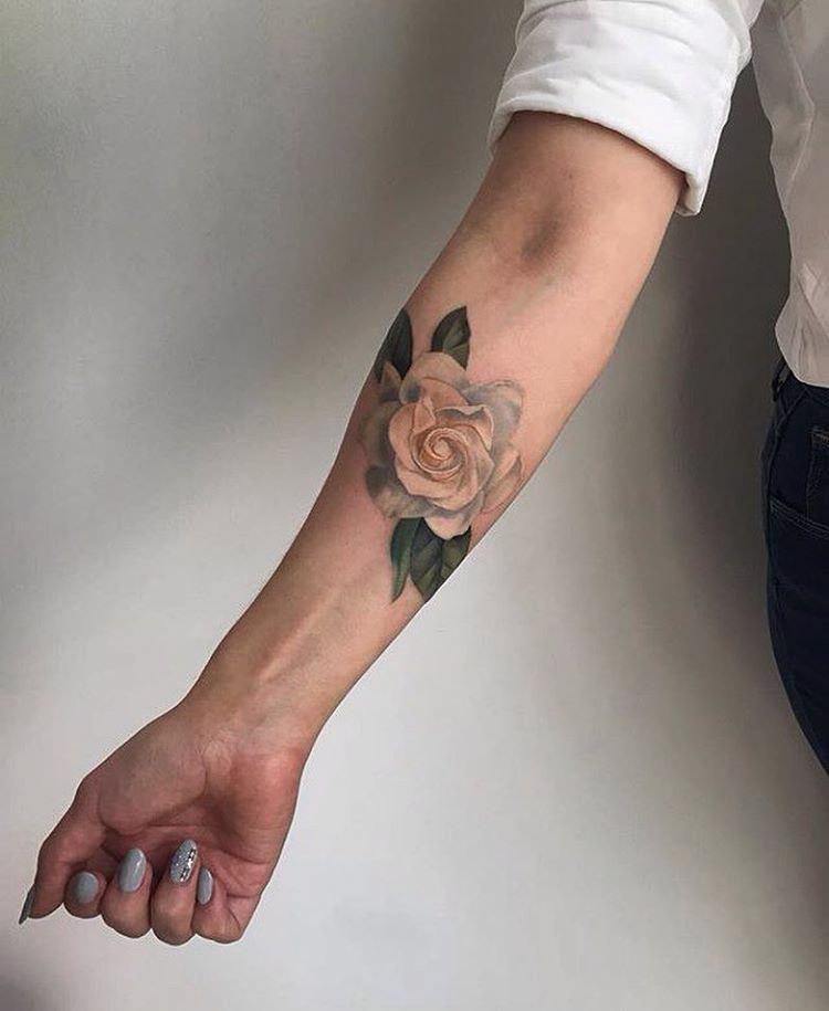 forearm tattoo of rose