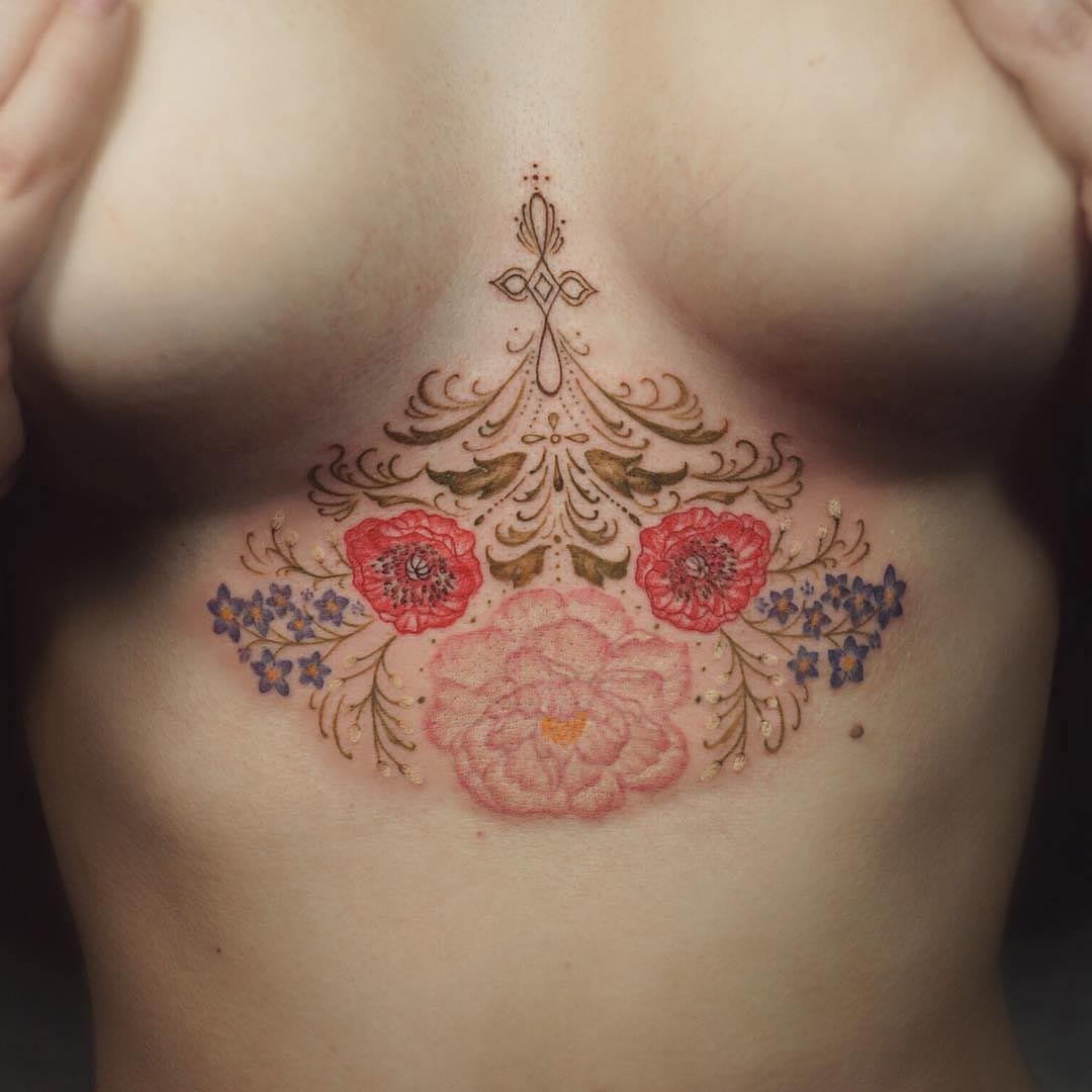 flower tatto underboobs