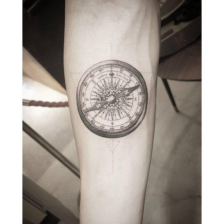 arm tattoo compass