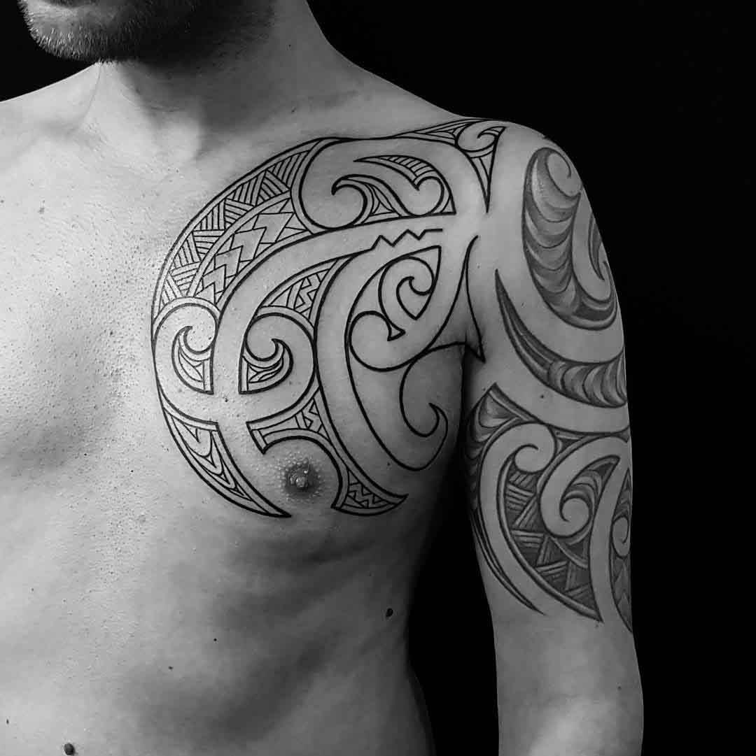 tribal tattoo on shoulder and chest