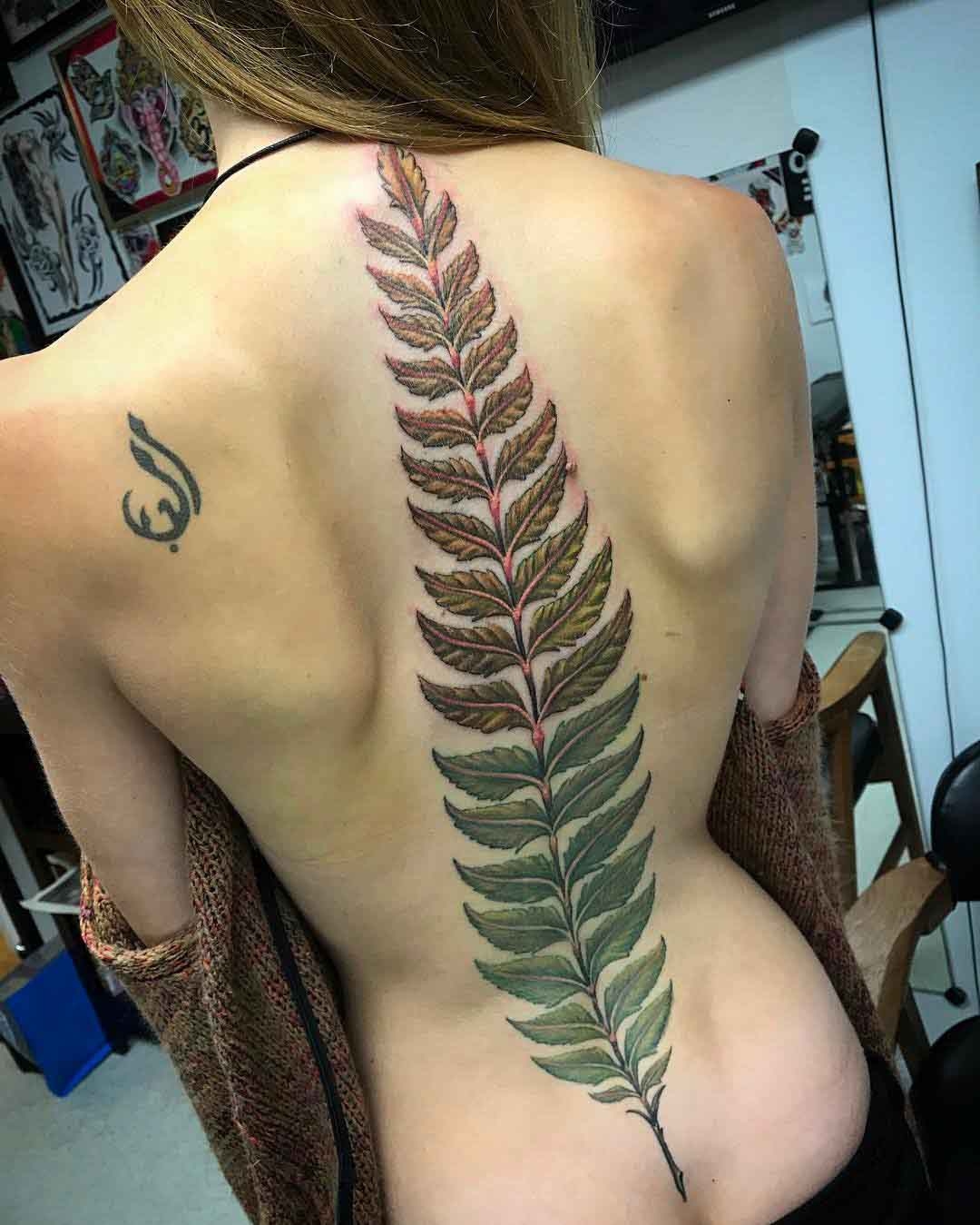 spine tattoo fern leaf big