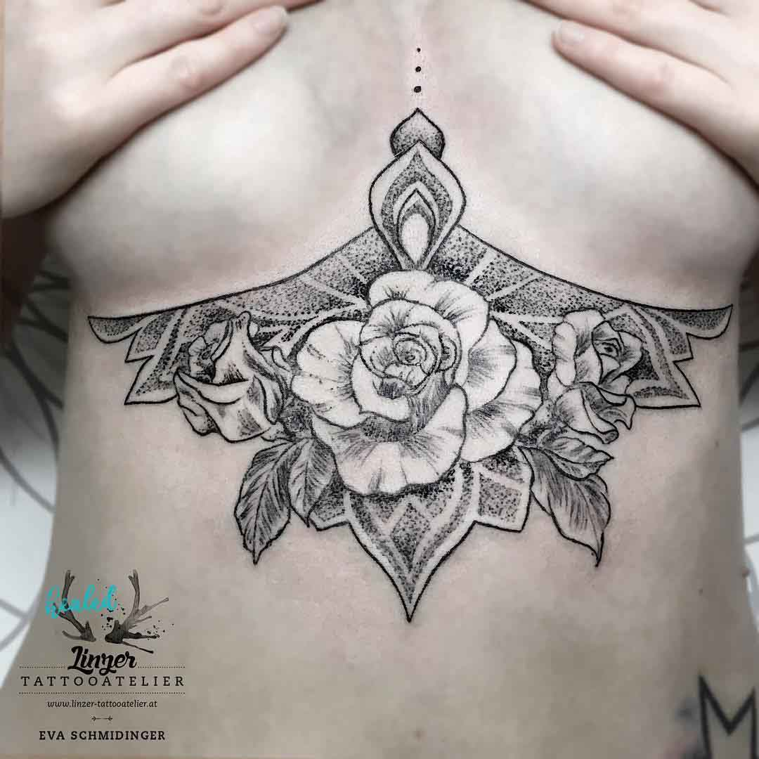under breasts tattoo of rose