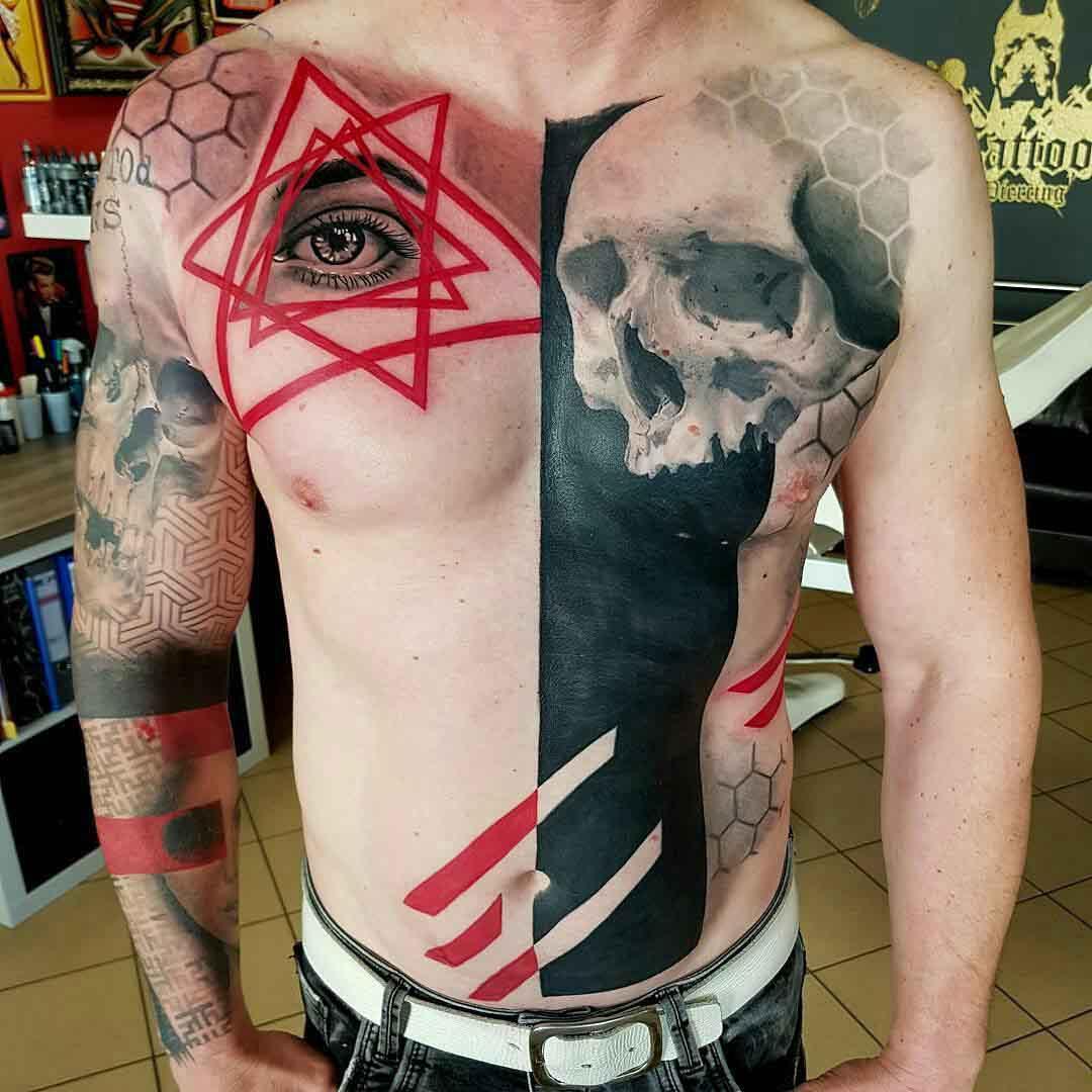trash polka tattoo on torso