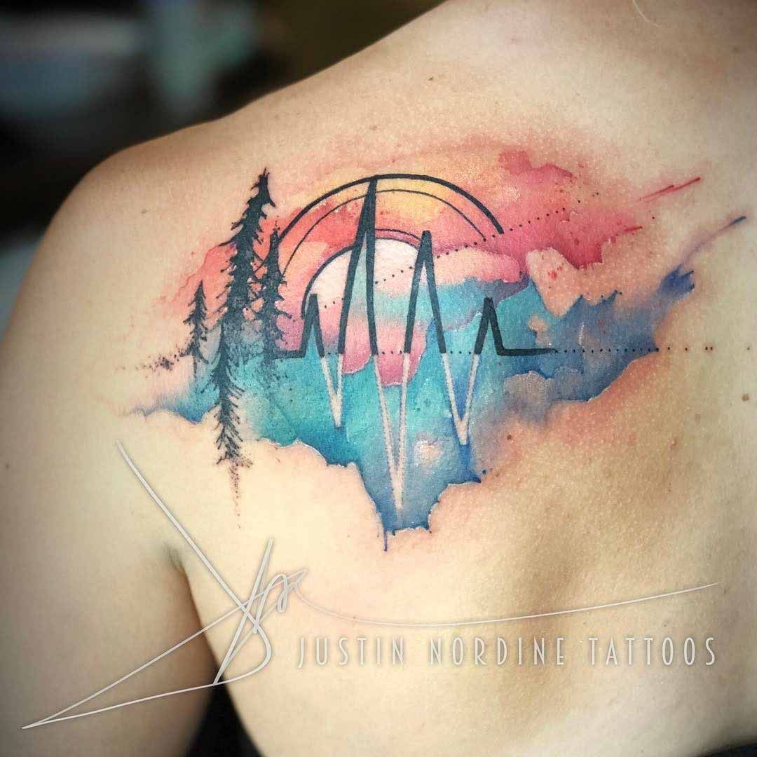 watercolor tattoo on shoulder blade pulse