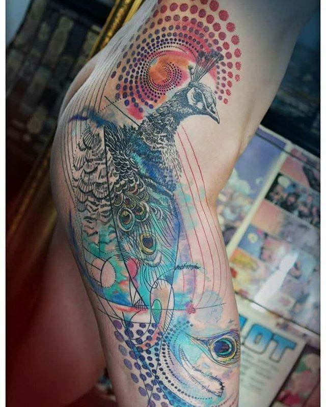 peacock tattoo on hip side
