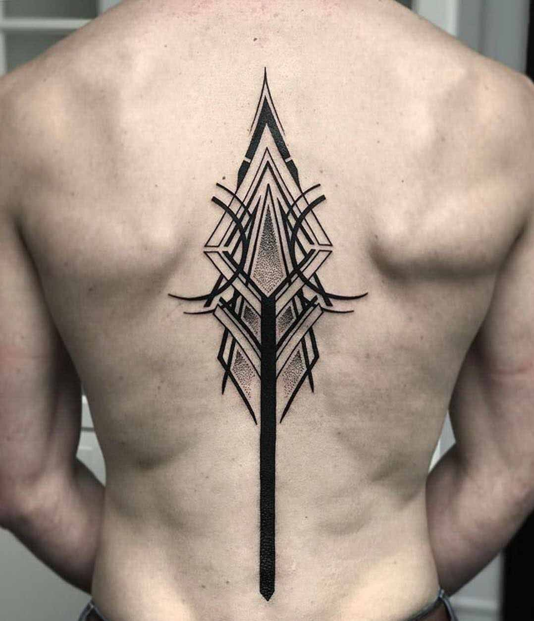 sumbolic spine tattoo