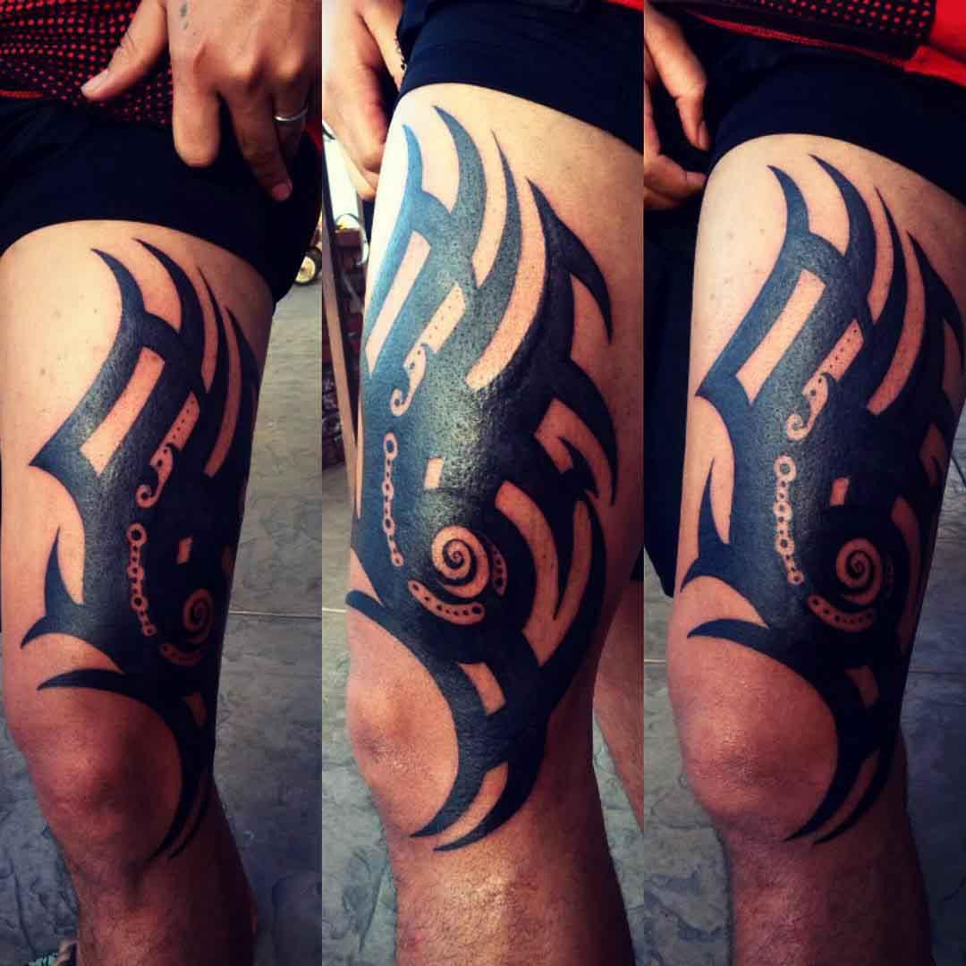 thigh tattoo tribal style