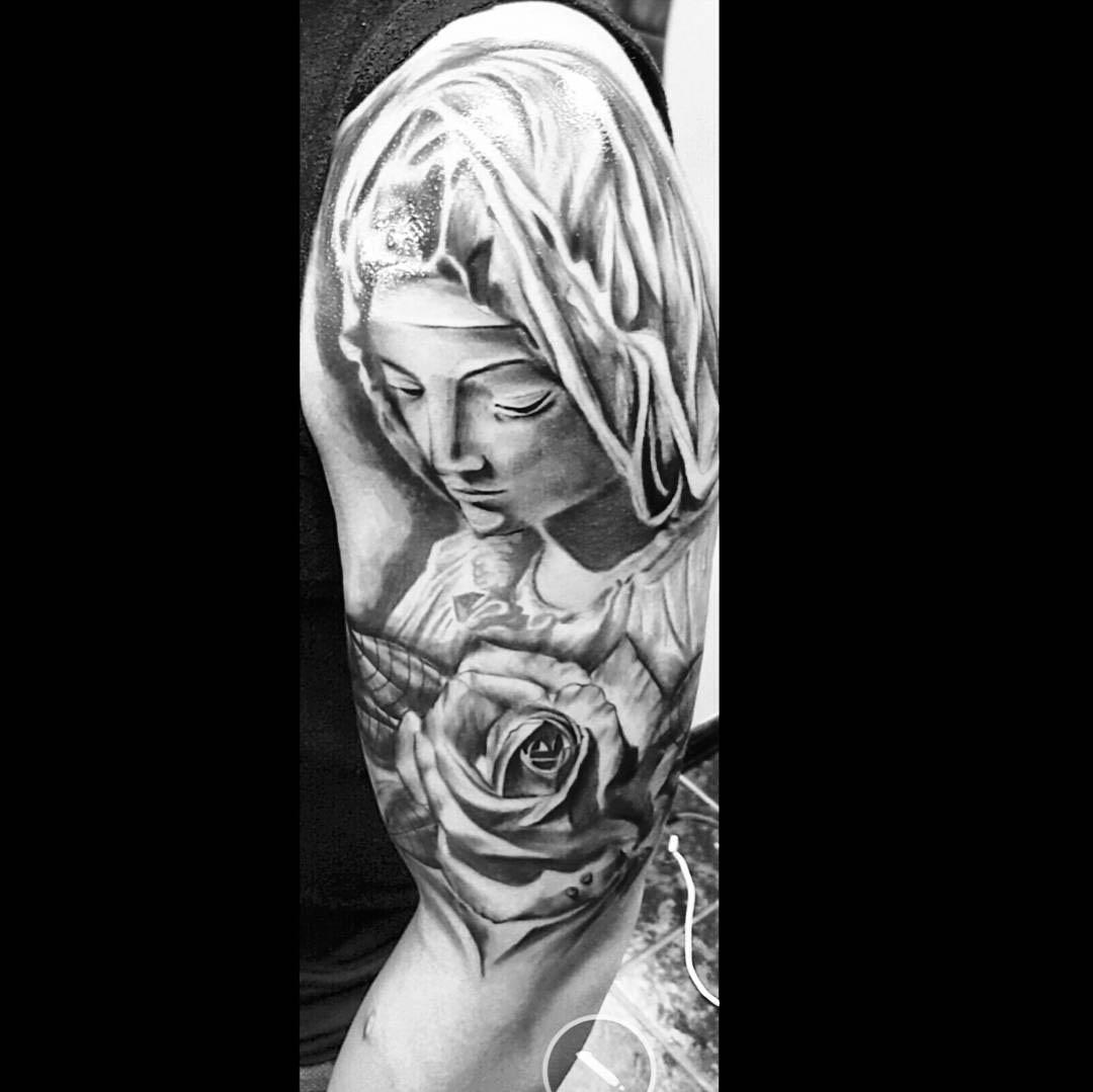 shoulder tattoo of Virgin Mary