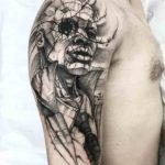 Cracked Portrait Tattoo on Shoulder