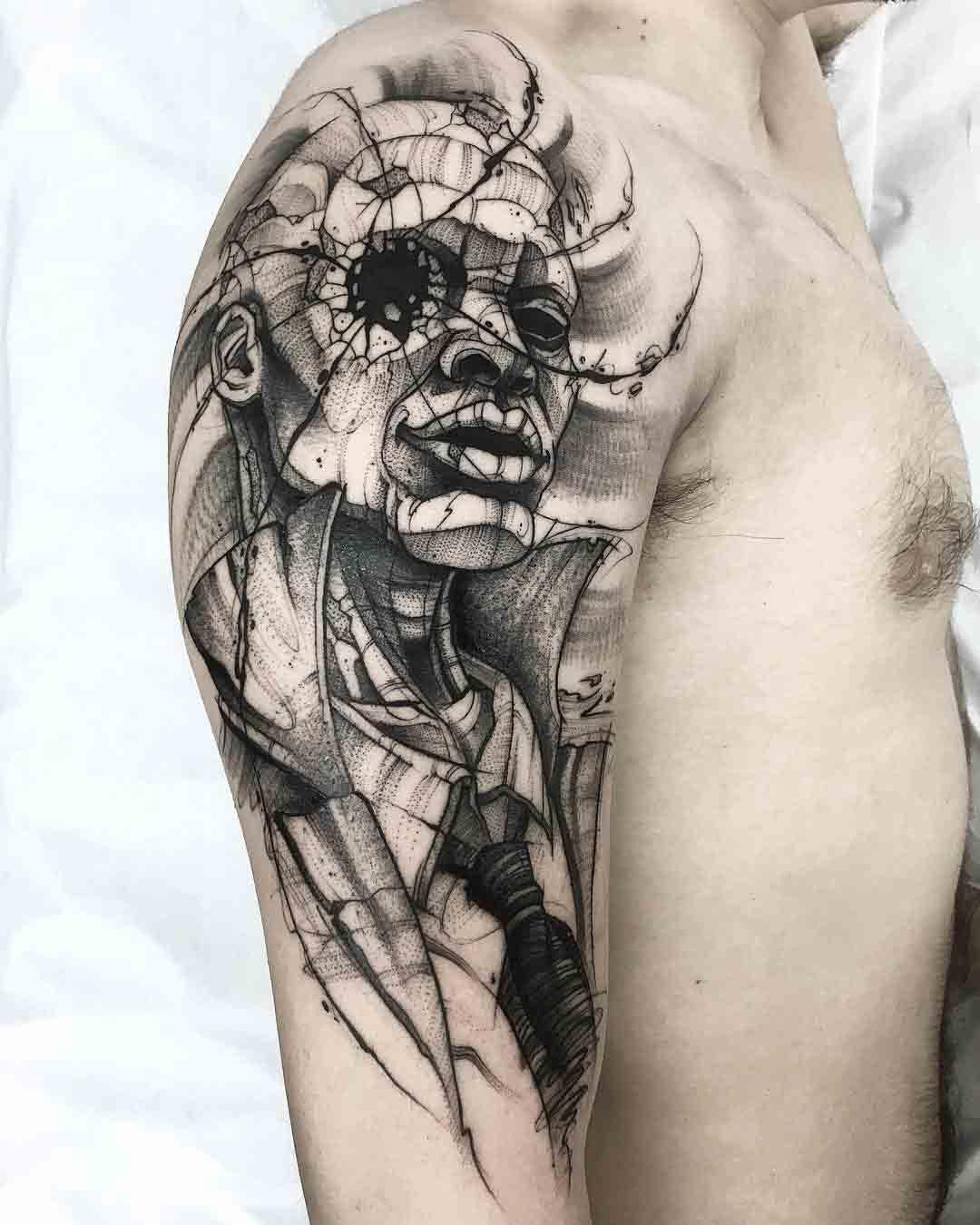 shoulder etching tattoo
