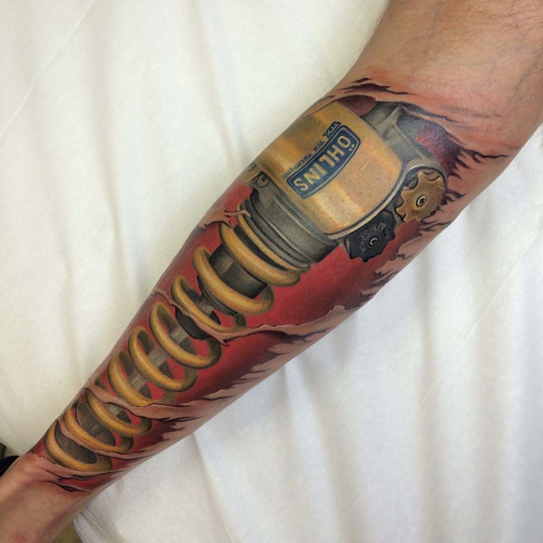 arm tattoo piston