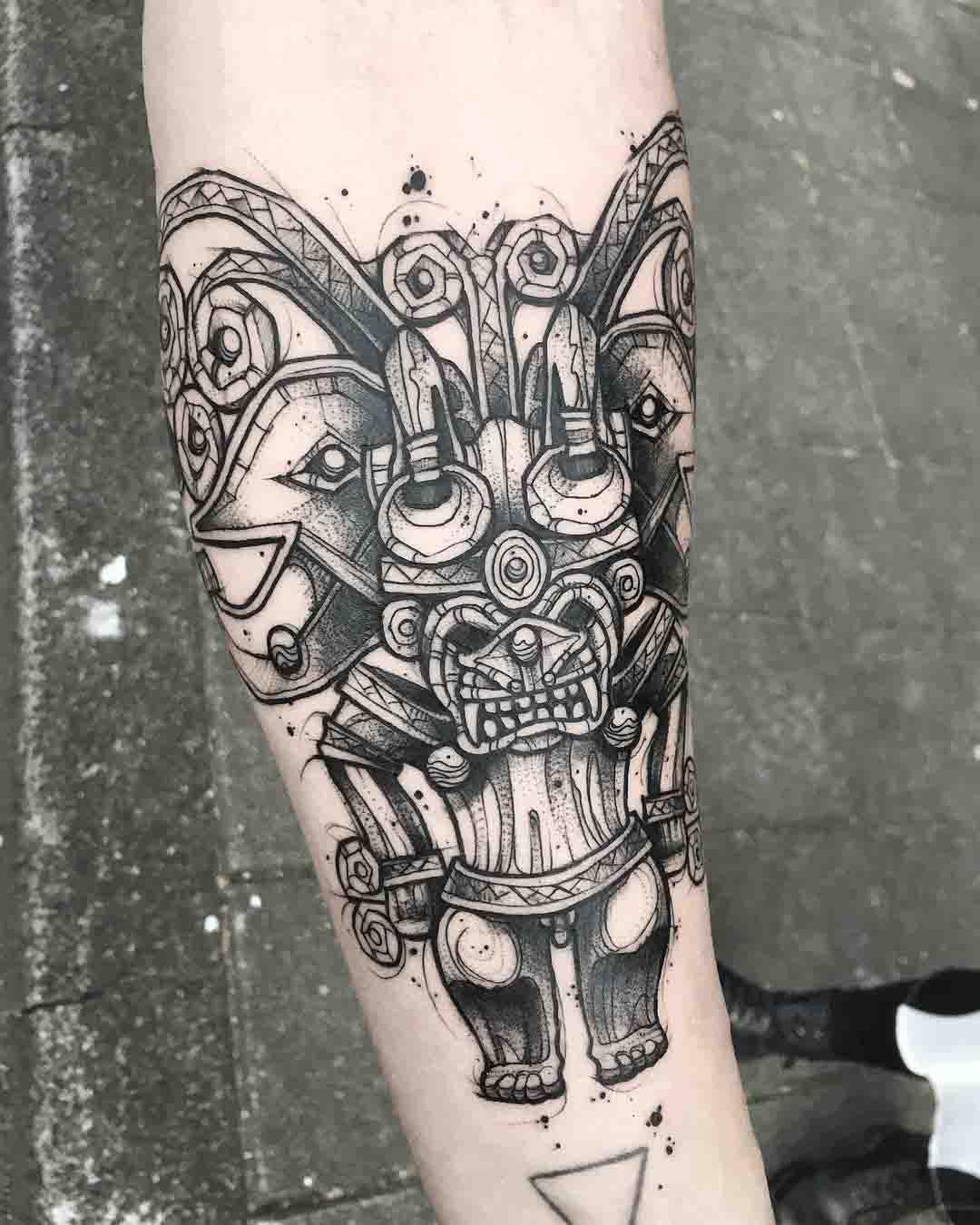 arm tattoo aztek god tattoo