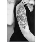 Shoulder Tattoo Flowers and Gun