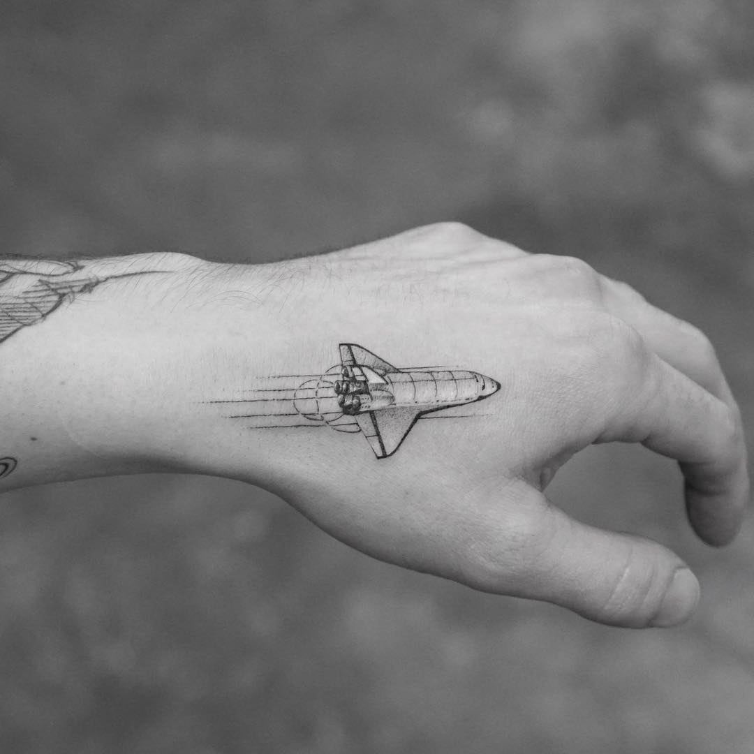 small shuttle tattoo