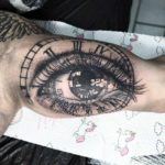 Clockface Eye Tattoo on Bicep