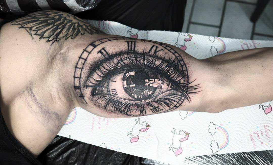 bicep tattoo eye
