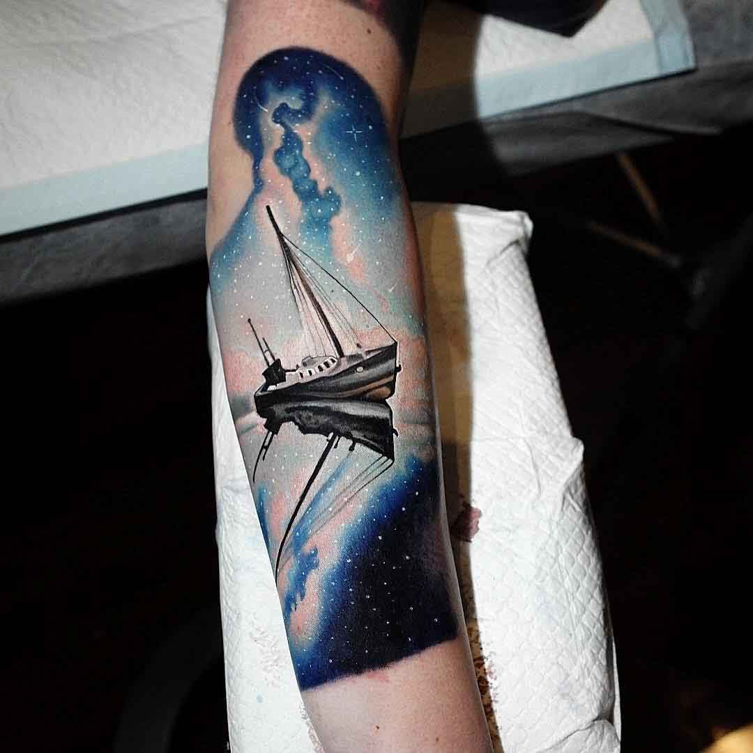 arm ship tattoo night sky