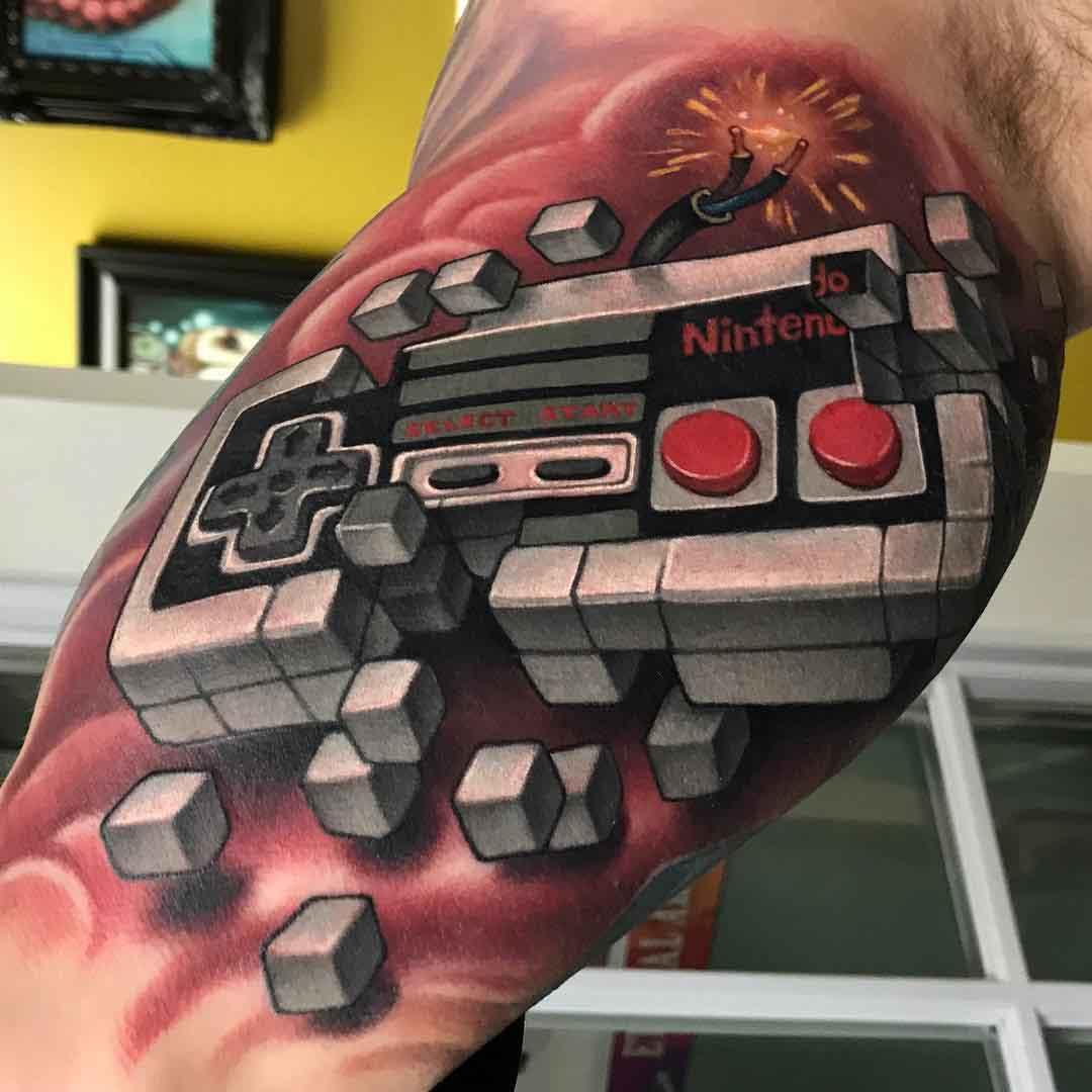 nintendo tattoo on bicep gamepad