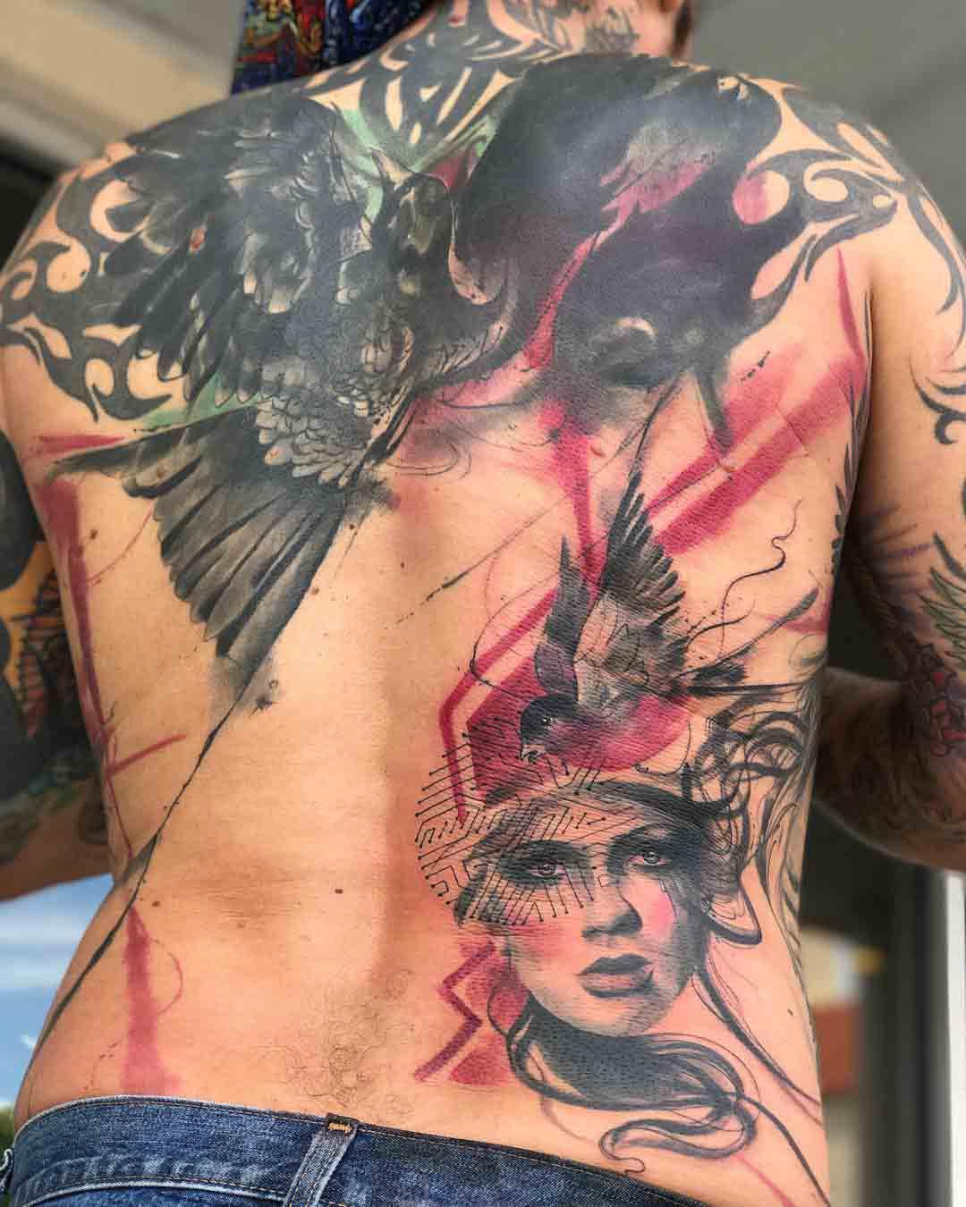 trash polka tattoo on back