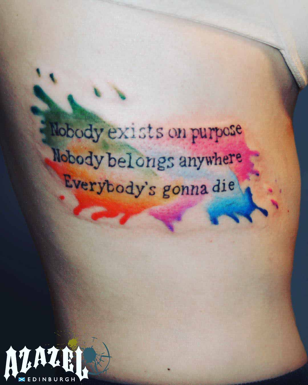 lettering tattoo on ribs