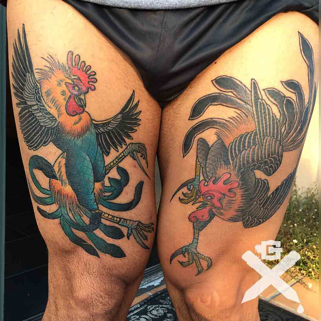 thigh tattoos fighting roosters