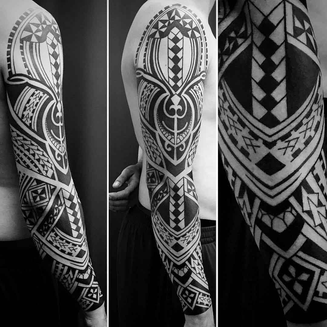 polynesian tattoo sleeve on full arm
