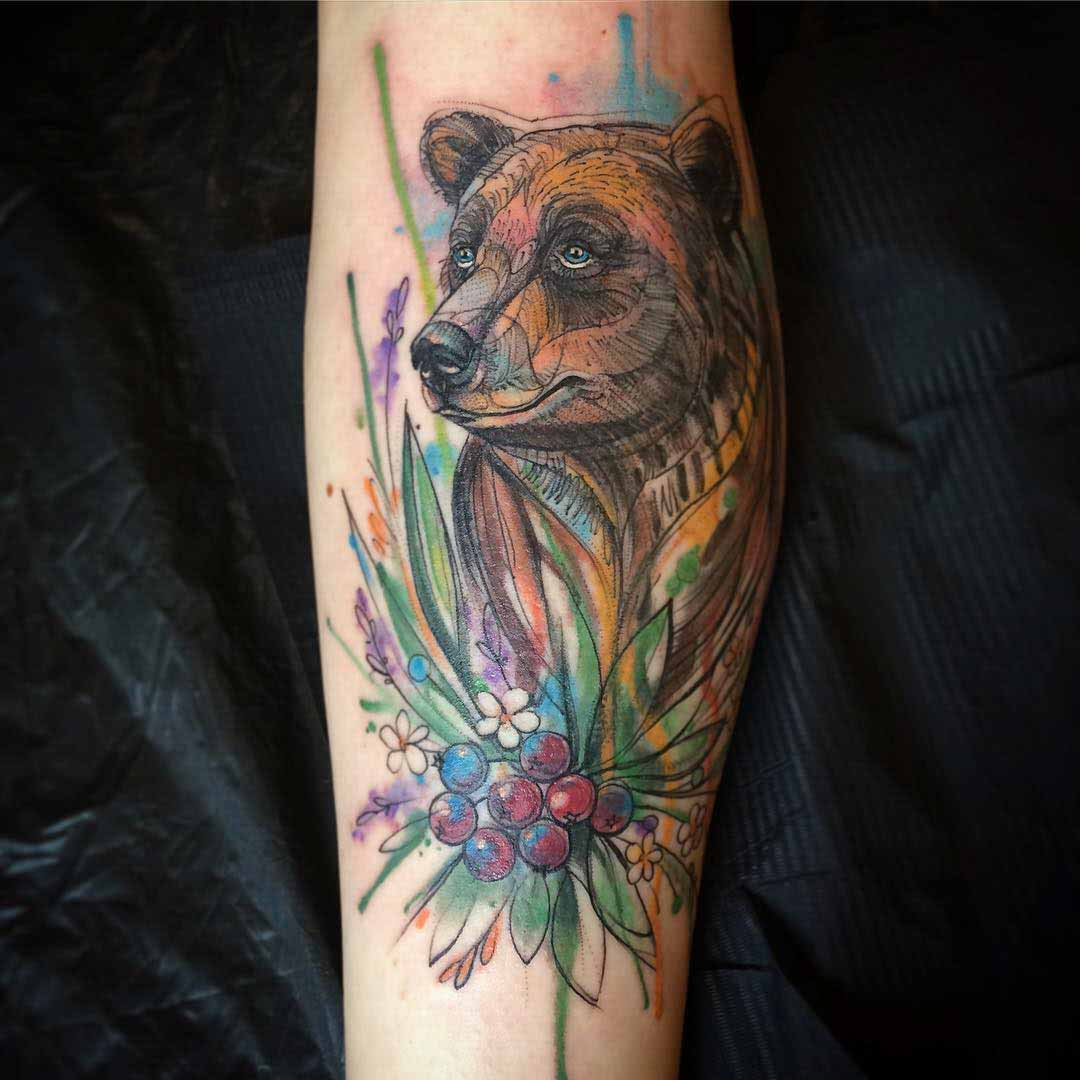 bear tattoo on arm watercolor style