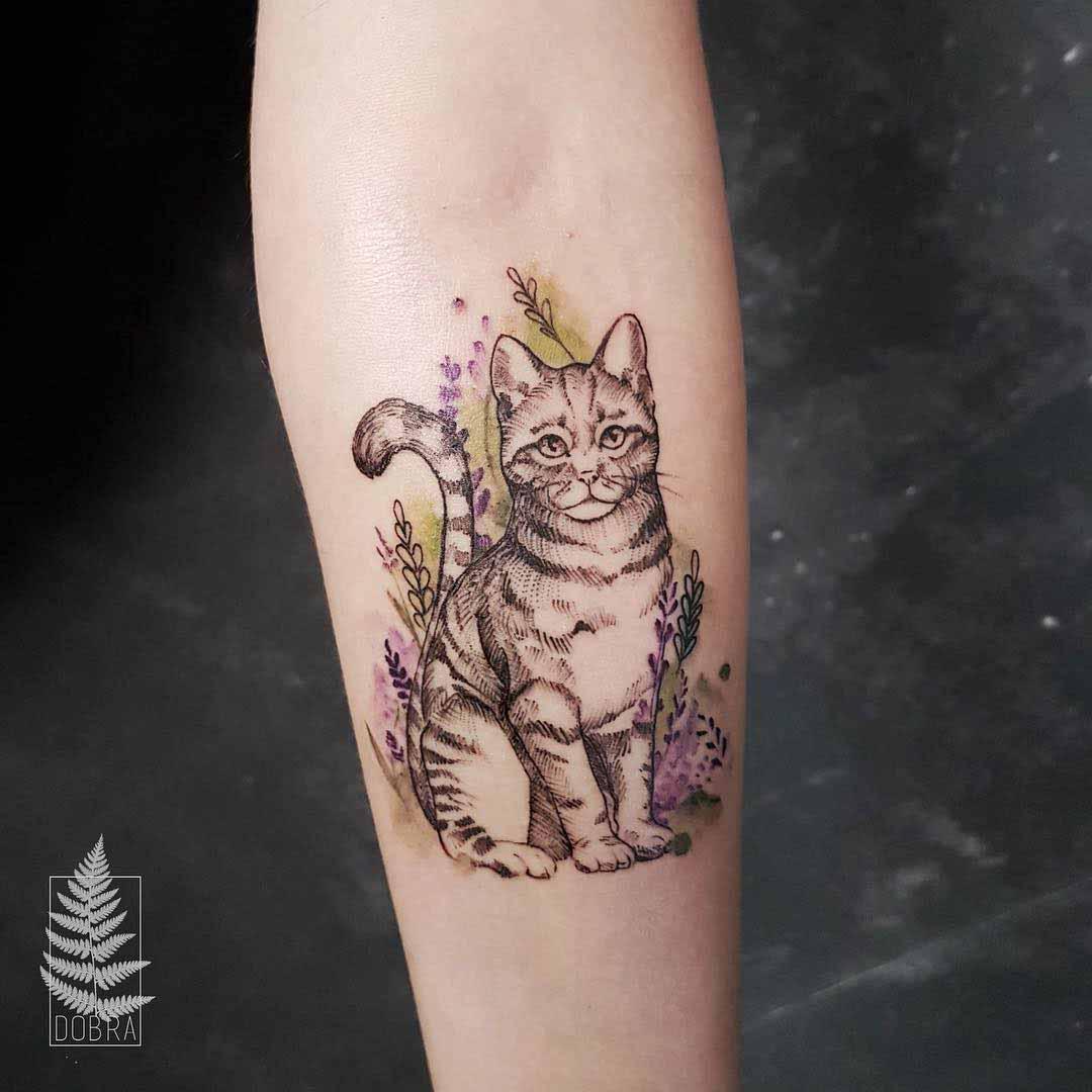 cat tattoo in flowers
