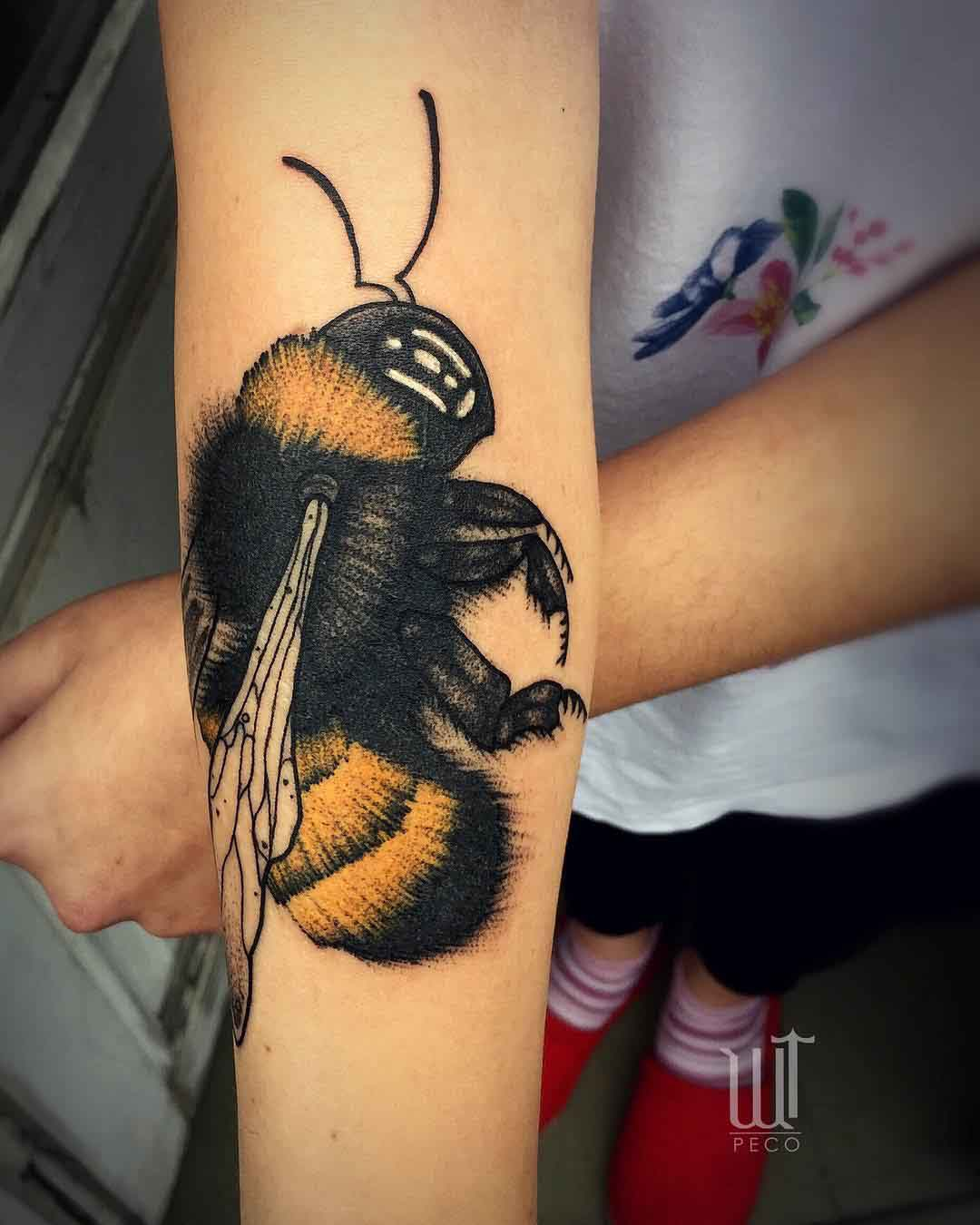 arm tattoo bumble bee