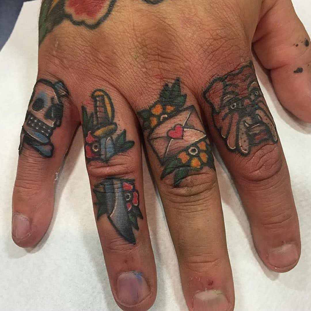 small traditional tattoos on fingers