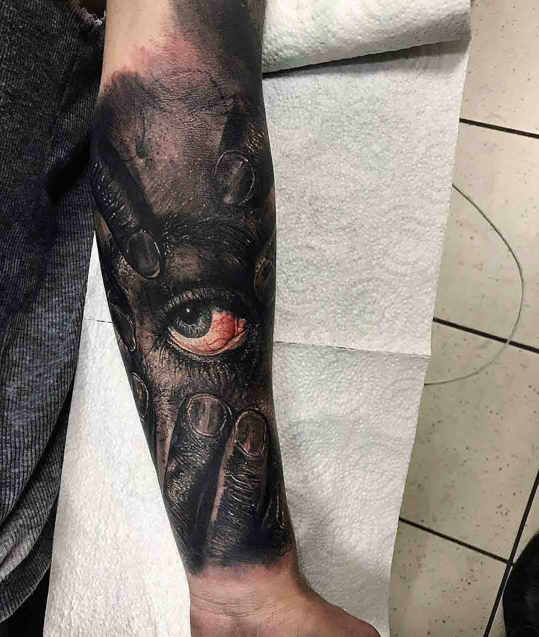 arm tattoo eye realistic style