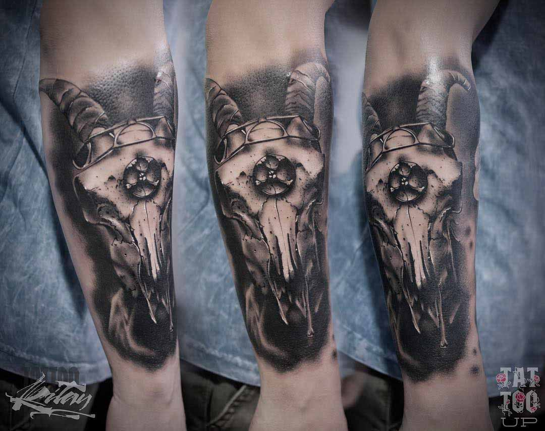 arm tattoo ram skull black and grey