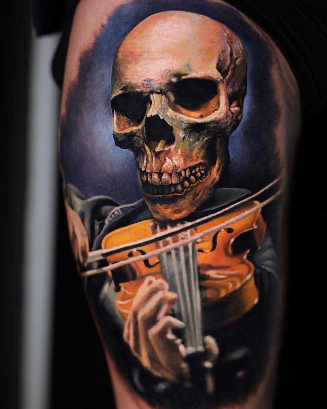 skull tattoo with violin
