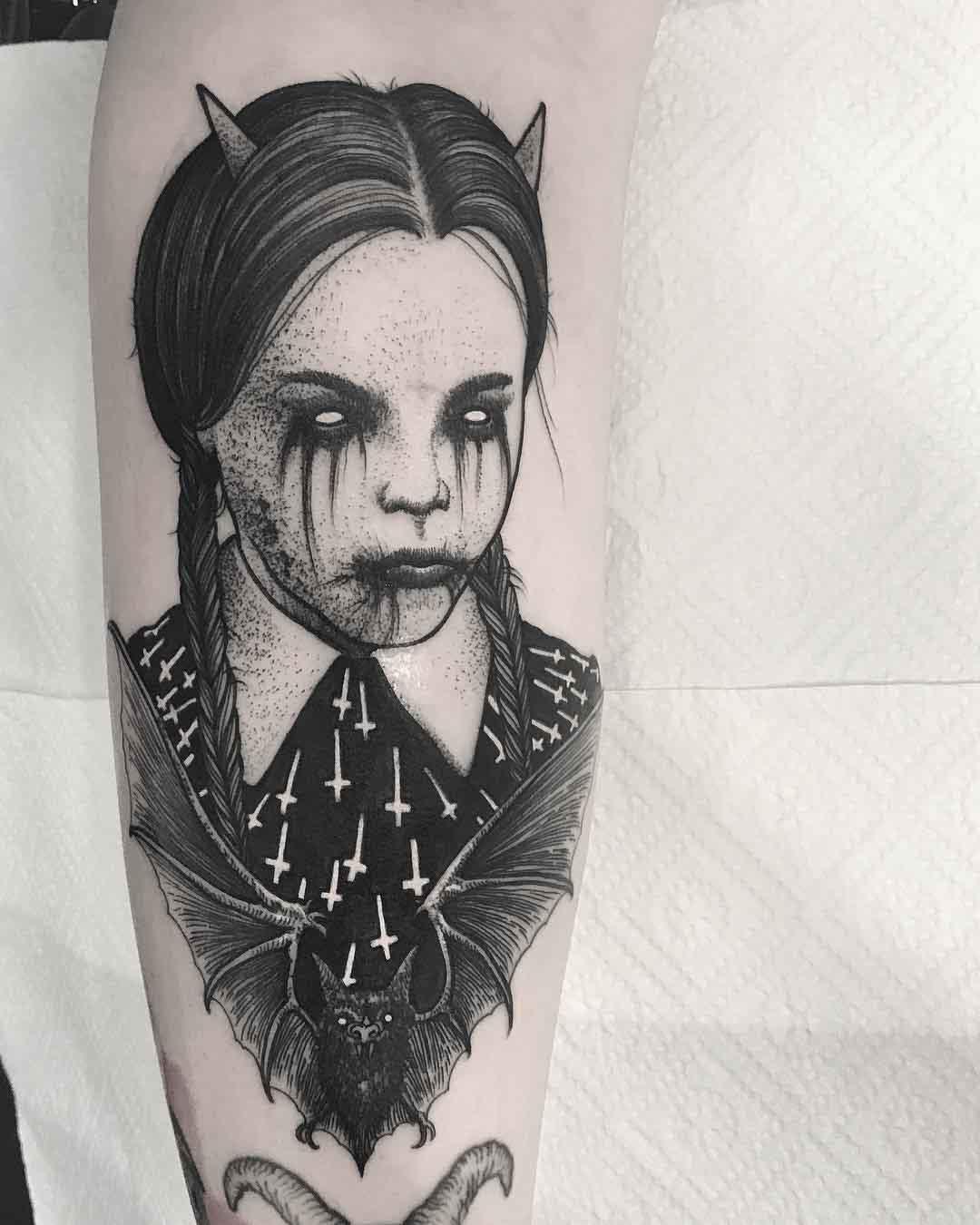 arm tattoo wenesday addams demonic
