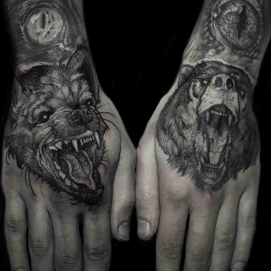 hyena tattoo and bear tattoo on hands