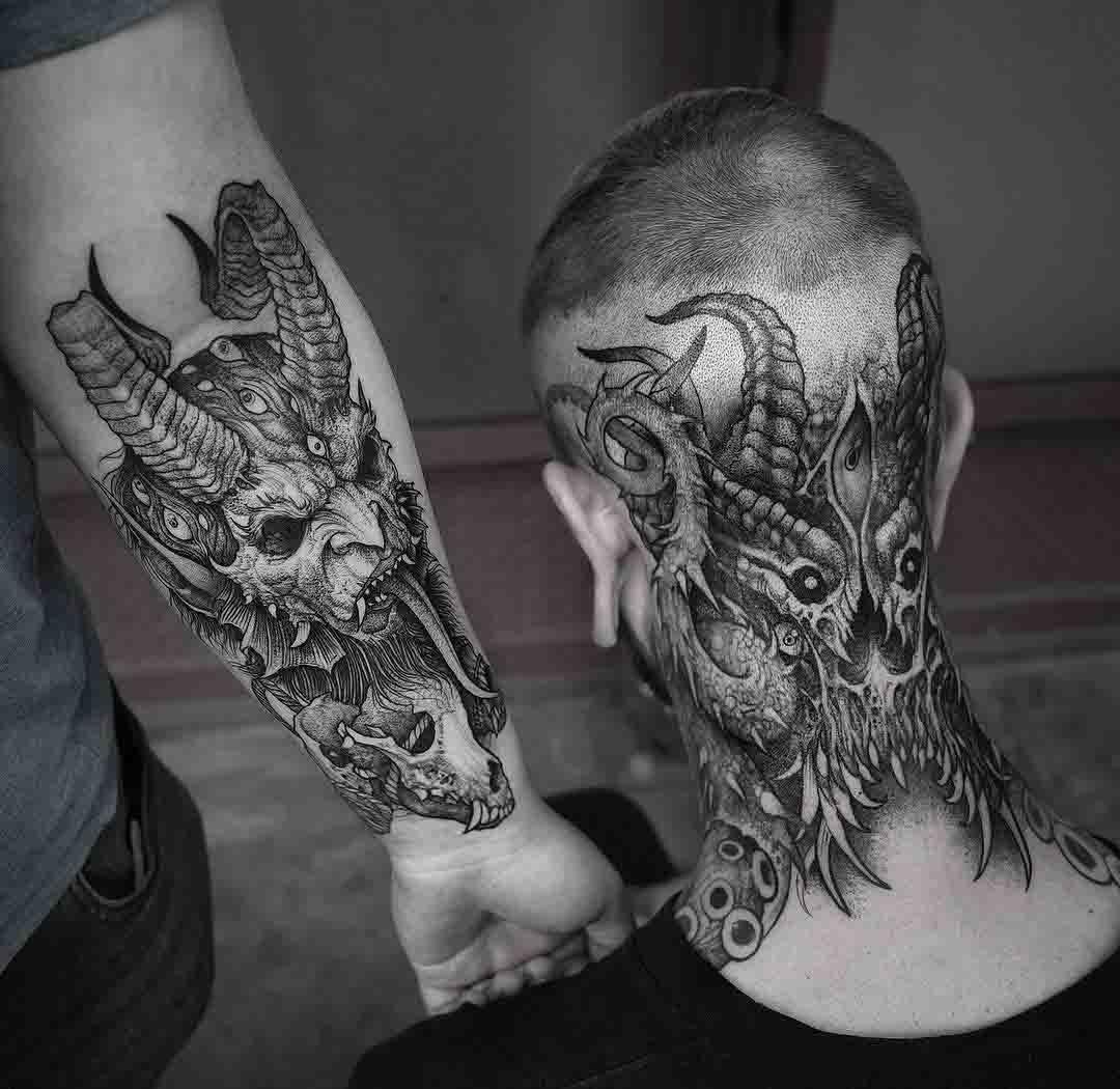 arm and neck demonic tattoos